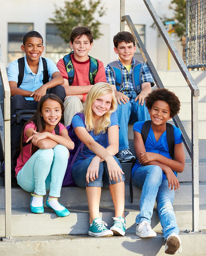children sitting on stairs